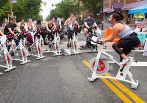 People take a spin class outdoors in the middle of Mount Vernon Street. (Photo: Well Ray)
