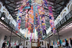 """Maya Freelon's """"Reciprocity Respite & Repass"""" hanging from the ceiling at the Smithsonian Arts and Industries Building. (Photo: Chris Ferenzi)"""