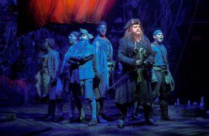 The cast of Blackbeard dressed as pirates on their ship. (Photo: Margot Schulman)