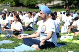 Ambassador Navtej Sarna and others doing yoga at last year's  International Day of Yoga. (Photo: Embassy of India)