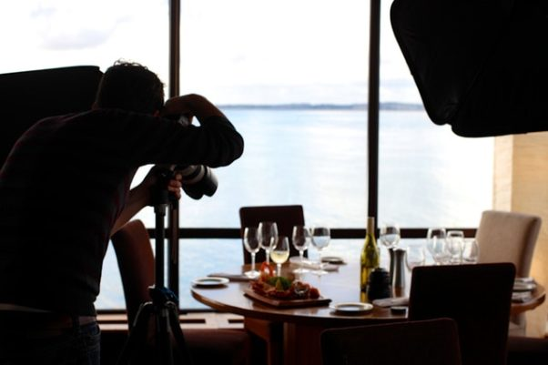 Photography taking a food photo in front of a window. (Photo: Pictography/Pexels)