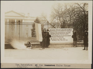 "Fourteen suffragists hold suffrage banners on the picket line in front of the White House in 1917. One banner reads: ""Mr. President How Long Must Women Wait For Liberty."" (Photo: Library of Congress)"