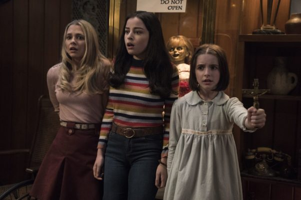 Mary Ellen (Madison Iseman), Daniela (Katie Sarife), the Annabelle doll and Judy Warren (McKenna Grace) (l to r) in the room where the Warrens keep the possessed items. (Photo: Warner Bros. Pictures)