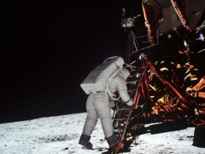 An astronaught with the moon rover on the moon's surface. (Photo: National Air and Space Museum)