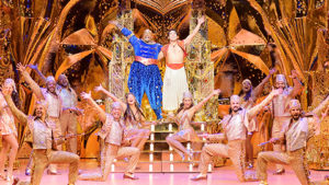 """The cast of """"Aladdin"""" on stage including Aladding and the genie. (Photo: Kennedy Center)"""