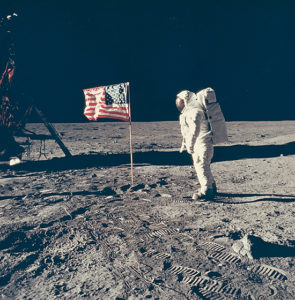 Buzz Aldrin posts with the U.S. Flag he had just planted on the moon. (Photo: Neil Armstrong)