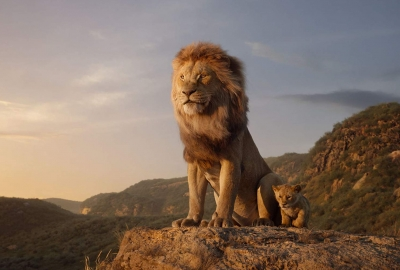 Scar and Simba sit together on top of a mountain. (Photo: Walt Disney Studios)