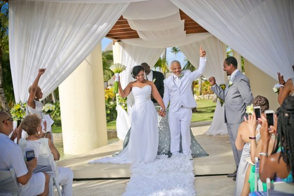 A black bride and groom with hands raised after being married. (Photo: TalentSmiths/Pixabay)