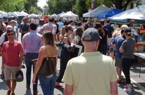 People walking among booths along 17th Street NW at a former festival. (Photo: 17th Street Festival)