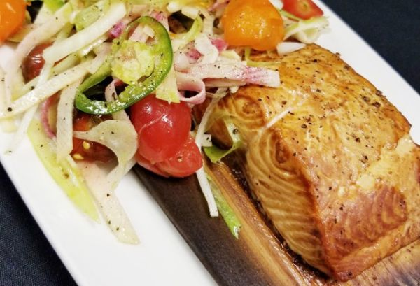 Salmon on a plate with tomatoes. (Photo: Oceanaire)