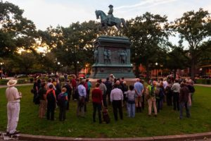 Visitors gathered aroudn a statue of Frederick Douglass while a range talks about it. (Photo: National Park Service)