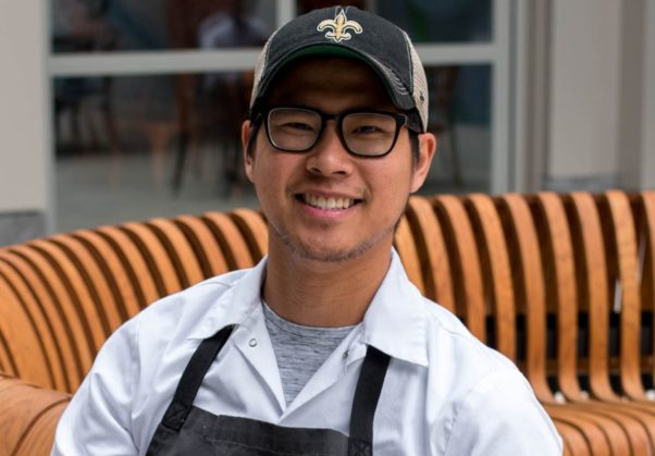 Kevin Tien in an apron and baseball cap. (Photo: Emilie's)