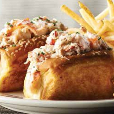 Twin petite lobster rolls on a plate with fries. (Photo: Oceanaire)