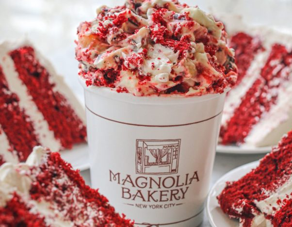 A container of red velvet banana pudding surrounded by slices of red velvet cake. (Photo: Magnolia Bakery)