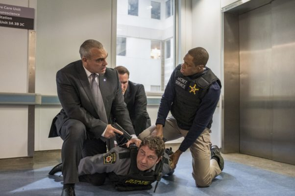 Gerard Butler stars as Mike Banning (Gerard Butler) is held on the floor by three police with guns pointed at him. (Photo: Jack English/Lionsgate Films)