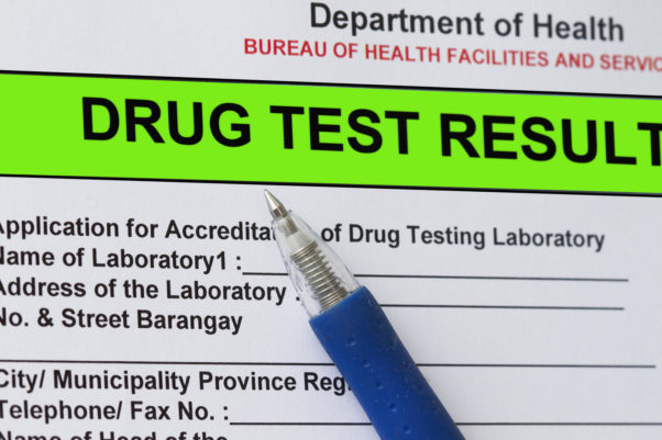 Macro shot of Drug test result form with blue pen. (Photo: Adobe Stock)