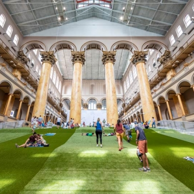 People on the artificial lawn build in the National Building Museum's Great Hall. (Photo: Timothy Schenck/National Buidling Museum)