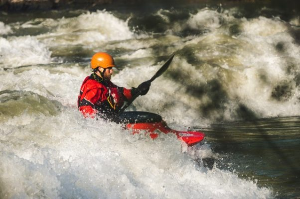 Man kayaking alone down rapids. (Photo: Brett Sayles/Pexels)