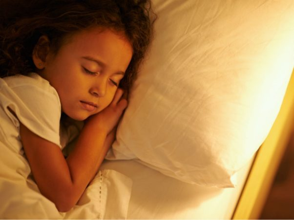 A young girl asleep in her bed. (Photo: iStock)