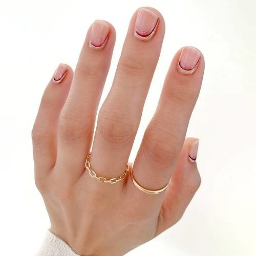 Woman's hand with short nails. (Photo: Betina Goldstein)