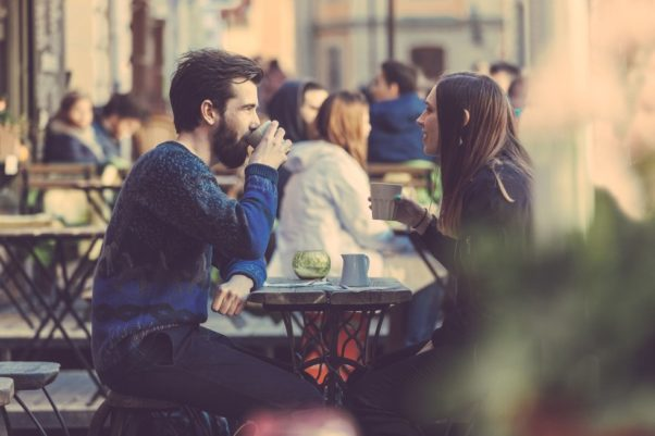 Man and woman talking and having coffee in a coffee shop. (Photo: Getty Images)