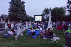People watching a movie in Congressional Cemetery. (Photo: Congressional Cemetery)