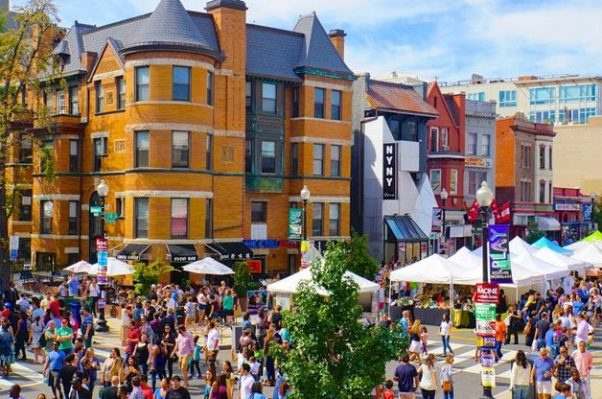 People walking among booths at the Adams Morgan Day Festival. (Photo: Christopher9000/Flickr)