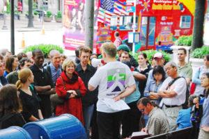 Participants on a tour listinent to a guide speak through a bull horn. (Photo: Cultural Tourism D.C.)