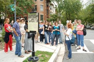 People on one of the WalkingTown D.C. tours listening to their tour guide. (Photo; Cultural Tourism D.C.)