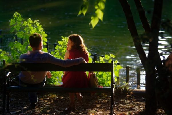 Couple sitting on a bench beside a lake. (Photo: Immortal Shots/Pexels)