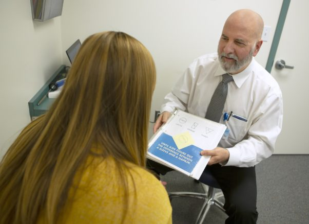 Dr. Charles Duffy examines Katherine Hirons for  concussion issues. (Photo: Penn State Health)