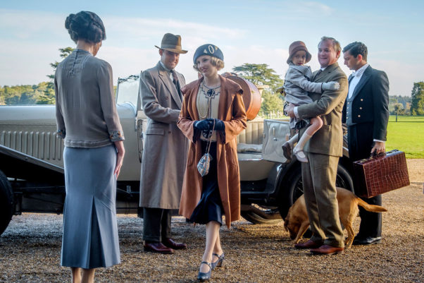 Lady Grantham (Elizabeth McGovern), Lord Hexham (Harry Hadden-Paton), Lady Hexam (Laura Carmichael), Lord Grantham (Hugh Bonneville) and Andy (Michael Fox) as Andy get out of a car as they return to Downton Abbey. (Photo: Jaap Buitendijk/Focus Features)