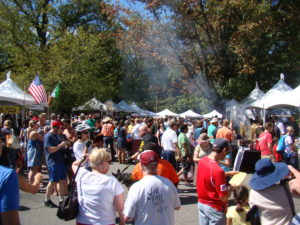 People wlak among booths set up at the Falls Church Festival. (Photo: Fall Church Recreation & Parks Dept.)