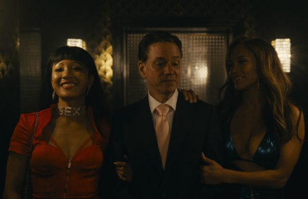 Constance Wu (left) and Jennifer Lopez (right) linking arms with a john. (Photo: STX Films)