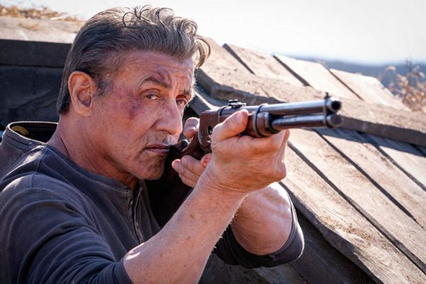 Rambo (Sylvester Stallone) stares down the barrel of a gun. (Photo: Lionsgate Films)