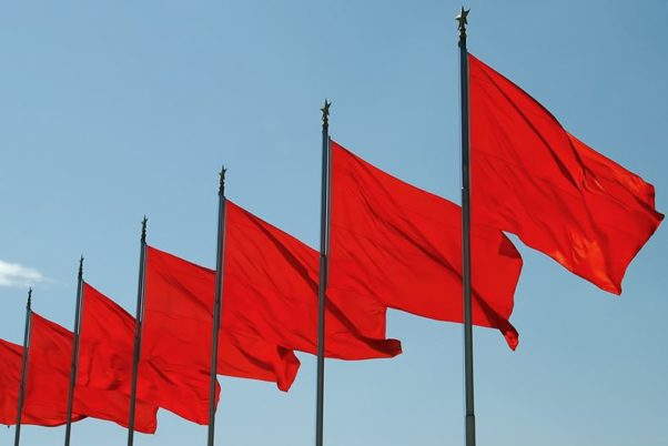 Five red flags on poles waving in the wind. (Photo: iStock)