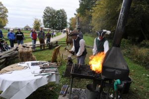 People watching blacksmiths making horseshoes. (Photo: Mount Vernon)