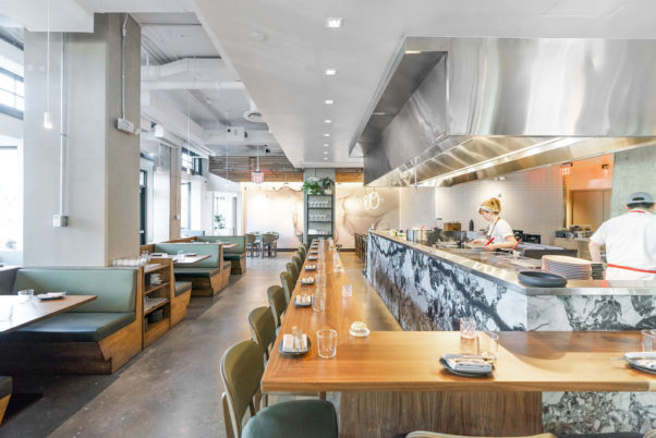 The interior of Emilie's showing booths, the chef's counter and open kitchen. (Photo: Anne Kim)