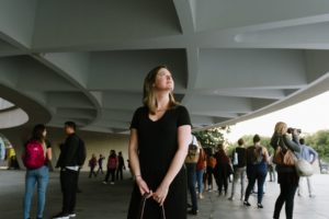 Woman standing in a crowd in the Hirshhorn's plaza. (Photo: Hirshhorn)