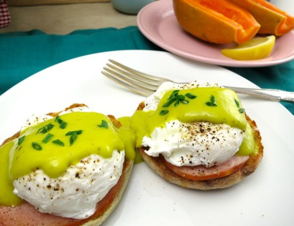 eggs benedict on a plate topped with green matcha sauce. (Photo: My Lilikoi Kitchen)