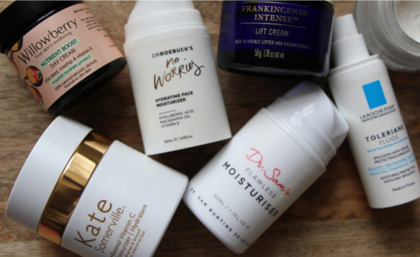 Photo of all the moisturizers featured in this post lying on a wooden counter. (Photo: Ruth Crilly)