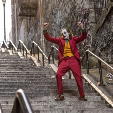 Joker dances on a long flight of outside steps. (Photo: Warner Bros. Pictures)