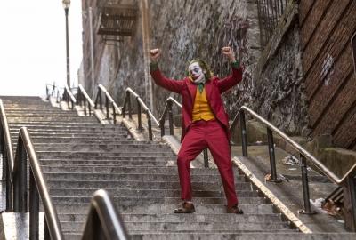 Joker dances on a long flight of outside steps. (Photo: Warner Bros. Pictures)