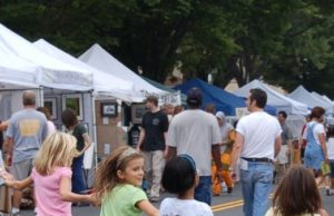 People stroll along Mount Vernon Avenue in Del Ray looking at artists' wares in booths. (Photo: Art on the Avenue)
