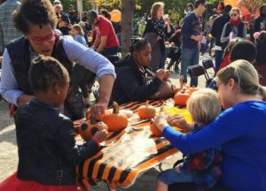 Children decorating pumpkins with their mothers. (Photo: Canal Park)