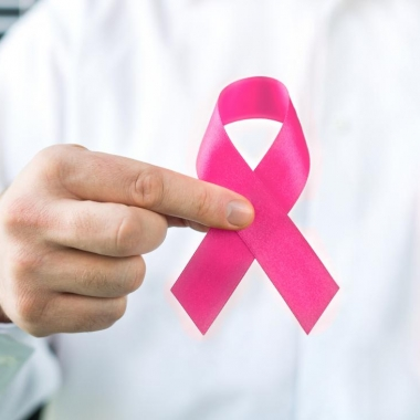 Doctor holding pink breast cancer awareness ribbon. (Photo: iStock)