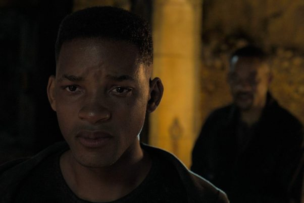 The cloned Henry Brogan (Wil Smith without goatee) stands in front of the original Henry Brogan (Will Smith with goatee). (Photo: UAR)