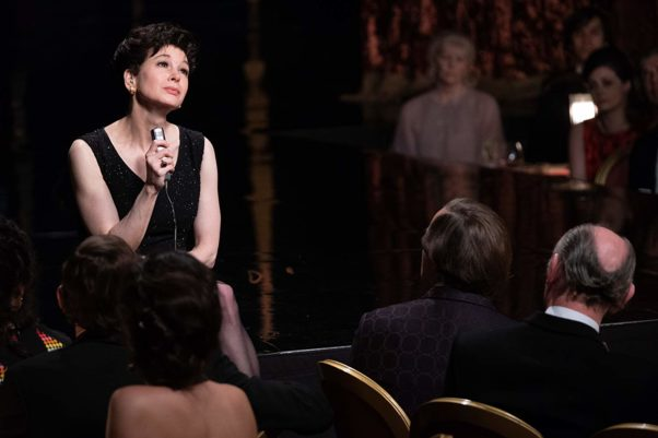 Judy Garland (Renee Zellweger) sits on stage and sings in front of an audience in a black dress. (Photo: Roadside Attractions)