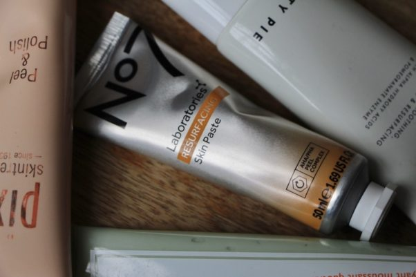 Tube of No7 Laboratories Resurfacing Skin Paste lying on a wooden counter. (Photo: Ruth Crilly)