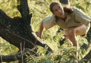 A young Jane Goodall climbing a tree in the jungle. (Photo: National Geographic Museum)